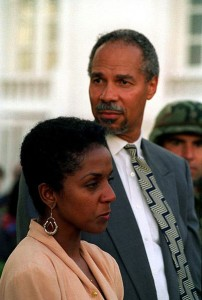 Robinson, shown here with his wife, Hazel, at an inaugural event in Haiti in 2004, quit TransAfrica three years earlier and exiled himself to the French Caribbean island of St. Kitts.  (U.S. Marine Corps)