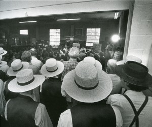 Amishmen listen in on a meeting about a proposed subdivision of a local farm into hundreds of housing plots.  (Free Library of Philadelphia)