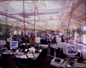 "No cubicles here.  Instead, ""reconfigurable"" power, date, and telecommunications connection dangle from the ceiling in this 1997 photo taken at the SEI Investments office in Oaks, Pennsylvania.  (National Building Museum, Courtesy Timothy Hursley, The Arkansas Office, Inc.)"