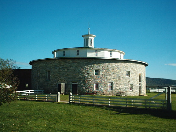 An unusual round, stone barn at the Hancock Shaker Village in western Massachusetts, near Pittsfield.  (eranb, Wikipedia Commons)