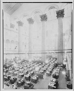 Washington's Pension Building, which is now the National Building Museum, once included these rows of desks in its magnificent atrium.  (Library of Congress)