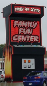"This oversized welcome structure outside a gaming parlor notwithstanding, not all video games are ""family fun.""  (KB35, Flickr Creative Commons)"