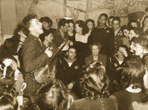 Pete Seeger, entertaining First Lady Eleanor Roosevelt and others at a labor canteen in 1944.  (Library of Congress)
