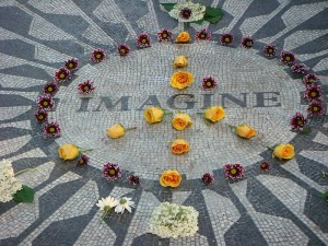 A peace sign made of flowers at the Strawberry Fields memorial.  (Killagb, Wikipedia Commons)