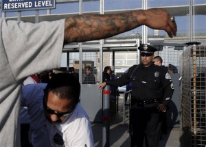 Security has been ramped up at L.A. Dodgers' games ever since the savage beating of a fan for merely wearing the opposing team's jersey.  (AP Photo/Jae C. Hong)
