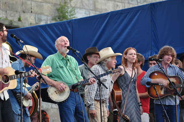 You get the spirit here, as Pete Seeger leads the ensemble at the Newport Folk Festival, which he helped found. (SWIMPHOTO, Flickr Creative Commons)