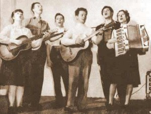 The Almanac Singers.  Pete Seeger's second from the left, with his banjo; that's Woody Guthrie in the middle, playin' the guitar.  (Library of Congress)