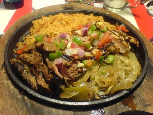 A fajita, this one containing chicken as well as steak, in the making.  (Elisa Arteaga, Flickr Creative Commons)