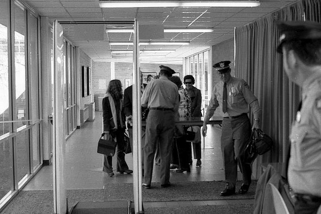 Modern airport security, brought to by D.B. Cooper and others.  (Hunter-Desportes, Flickr Creative Commons)