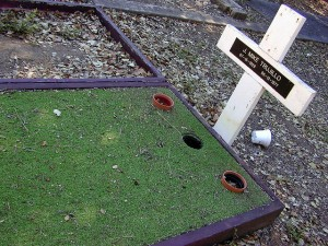 This is not a clever course obstacle.  It's an actual grave of what, we can only presume, was a serious mini-golf enthusiast. (Dawn Endico, Flickr Creative Commons)