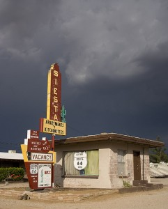 It's a dark day, in more ways thanone, at the Siesta Motel on U.S. Rout 66 in Kingman, Arizona.  America's most famous national highway still has passionate devotees, however.  (Carol M. Highsmith)