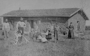 "A family poses before their Custer County, Nebraska, sod house in 1886.  A ""soddie"" was one of the few options on the plains, where trees were scarce.  (Library of Congress)"