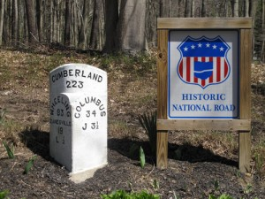 Signs old and new adjoin each other along the old road in eastern Ohio. (Ted Landphair)
