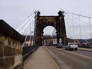 The Wheeling Suspension Bridge, over which The National Road still runs, looks its age, for sure. (Chris Light, Wikipedia Commons)