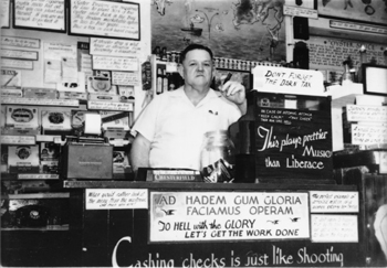 This looks like a more svelte Oliver at the cash register in Wintzell's early days.  His slogans were everywhere even then.  (Wintzell's)