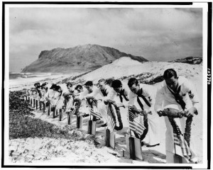 Seamen at Kaneohe Naval Air Station in Hawaii decorate the graves of their fellow fallen sailors.  (Library of Congress)
