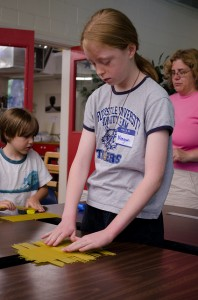 "Students being homeschooled make a ""pasta bridge.""  (qwrrty, Flickr Creative Commons)"