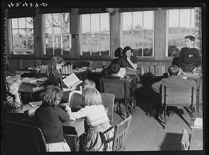 A teacher, Miss Holmes, watches over her flock in a Connecticut one-room schoolhouse in 1940.  (Library of Congress)