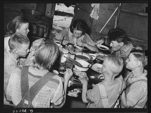 A family dinner after a day of chopping cotton. (Library of Congress)