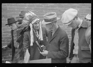 The fellow in the headdress is selling patent medicine at a medicine show in Huntingdon, Tennessee, in 1935.  (Library of Congress)