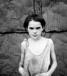 A shacktown child from Oklahoma.  She looks a lot like my middle daughter, Juliette, at her age.  Julie, though, was better fed.  (Library of Congress)