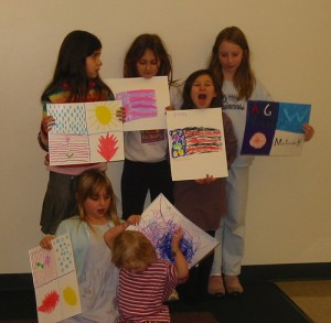 Homeschooled students, who might or might not be from one family, show off sketches they drew after learning about flags.  (mia3mom, Flickr Creative Commons)