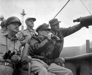General MacArthur, raising binoculars to his eyes, observes the shelling of Inchon from a U.S. battleship. (U.S. Army)