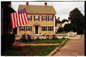 This place has it all: the house, the white-picket fence, even a flag.  (Mike Babiarz, Flickr Creative Commons)