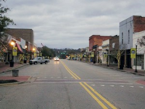 I caught this shot of downtown Prattville at dusk on a Sunday, almost as an afterthought after visiting the gin-factory site, which was just behind me as I photographed up Main Street.  (Ted Landphair)