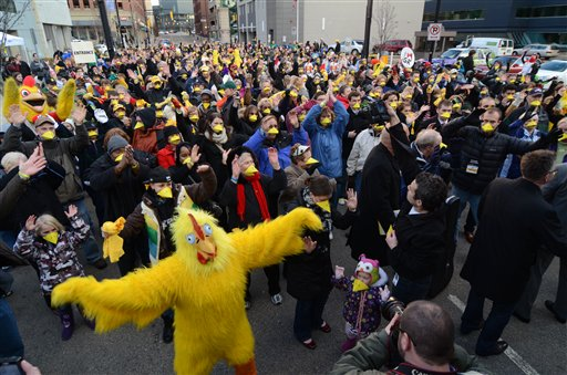 Some 607 people wearing fake chicken beaks set a world record for animal noses at a single venue in Grand Rapids, Michigan, in March.  (AP Photo)