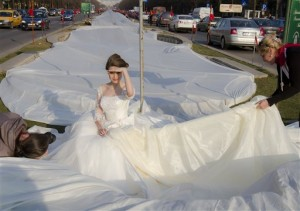 This photo of Emma Dumitrescu, 17, in Bucharest, Romania, isn't large enough to see ALL of her world-record bridal-gown train.  (Vadim Ghirda/AP Photo)