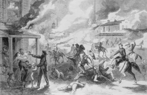 "This woodcut from ""Harper's Weekly"" magazine depicts Quantrill's Raiders' descent upon Lawrence.  (Library of Congress)"