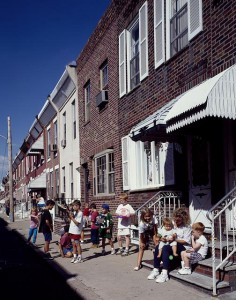 Family time on a rowhouse street in South Philadelphia.  (Carol M. Highsmith)