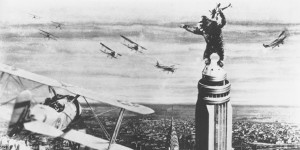 In this publicity still, King Kong fends off biplanes.  (AP Photo)