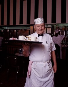 Waiter Linus Noel delivers a plate of savory beignets and cups of tart chicory coffee at the French Quarter's Cafe du Monde.  (Carol M. Highsmith)