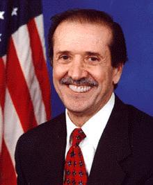 Sonny Bono had longer hair and wore beads when he was singing with Cher.  Here, he's a congressman.