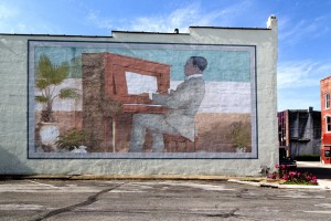 A mural on the side of an old furniture outlet downtown shows Scott Joplin at work.  (Carol M. Highsmith)