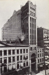 The skinny Tower Building is the central portion, with the archway at street level. It's long gone from the streetscape. (nyc-architecture.com)