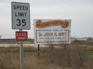 Seeing this sign, one would think the Postville is another humdrum Midwest town.  John Mott was a Protestant leader and onetime president of the national Y.M.C.A. (pCka, Flickr Creative Commons)