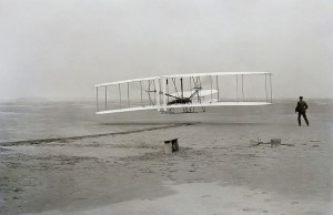 One of history's most significant photographs, of Orville in the air during the first flight, and Wilbur running behind.  (Library of Congress)