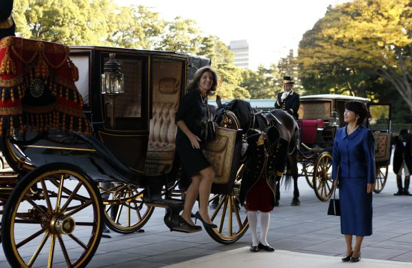 Newly appointed U.S. ambassador to Japan Caroline Kennedy gets out of a horse-drawn carriage as she arrives at the Imperial Palace in Tokyo