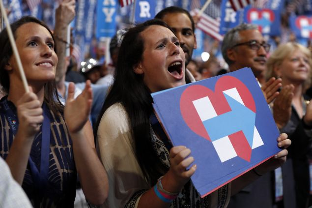 Supporters react as Democratic presidential nominee Hillary Clinton speaks during the final day of the Democratic National Convention in Philadelphia, Thursday, July 28, 2016. (AP Photo/Carolyn Kaster)