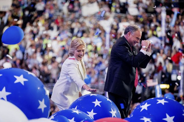 Democratic presidential candidate Hillary Clinton and Democratic vice presidential candidate, Sen. Tim Kaine, D-Va., right, stand on stage during the final day of the Democratic National Convention in Philadelphia, Thursday, July 28, 2016. (AP Photo/Andrew Harnik)