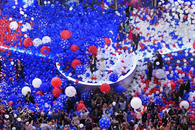 Democratic vice presidential nominee Sen. Tim Kaine, D-Va., and Democratic presidential nominee Hillary Clinton are surrounded by falling balloons at the conclusion of the Democratic National Convention in Philadelphia , Friday, July 29, 2016. (AP Photo/Mark J. Terrill)