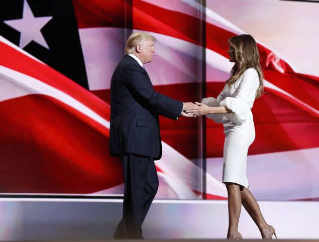 Melania Trump greets her husband Republican U.S. presidential candidate Donald Trump onstage at the Republican National Convention in Cleveland, Ohio, U.S. July 18, 2016. REUTERS/Mark Kauzlarich - RTSIMGH