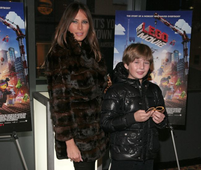 """Melania Trump, left, and her son Barron William Trump, right, attend a screening of """"The Lego Movie"""" hosted by Warner Bros. Pictures and Village Roadshow Pictures on Wednesday, Feb. 5, 2014 in New York. (Photo by Andy Kropa/Invision/AP)"""