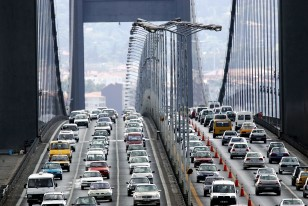 Motorists drive over the Bosphorus suspension bridge linking the city's Asian and European sides in ..