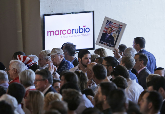 Supporters of Florida Sen. Marco Rubio wait for him to appear during a rally at the Freedom Tower on April 13, 2015, in Miami. (AP/Wilfredo Lee)