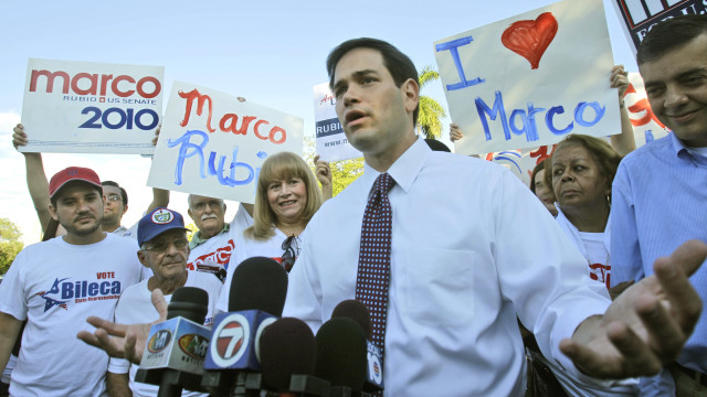 In the file photo, Republican Senate candidate Marco Rubio talks to reporters in Miami on Oct. 20, 2010.  (AP /Alan Diaz)