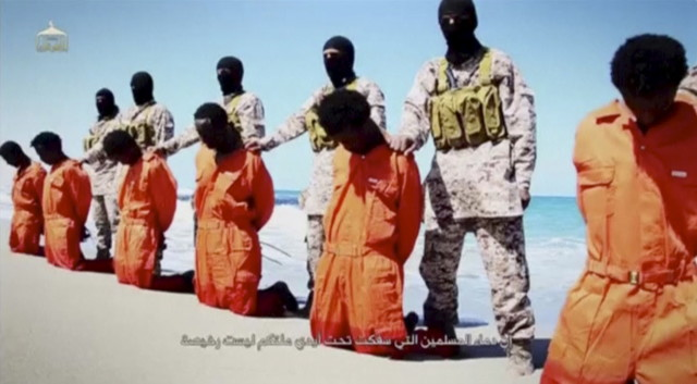 Islamic State militants stand behind what are said to be Ethiopian Christians in this still image from an undated video made available on a social media website on April 19, 2015.  (Reuters)